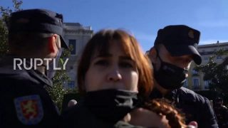 Spain: Topless Femen activists arrested after storming Franco rally event *EXPLICIT*