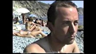Home movie of topless sunbather
